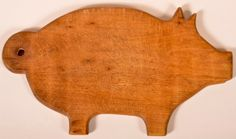 "Conestoga Auctions -  Harry B. Hartman Estate Auction - Session II  May 16, 2015.  Lot 547.     Estimate:	$50 – $100.  Sold: $424.    Description:  Pig Form Cutting Board with Hanging Hole In Tail. 9-1/4""h. x 16-1/4""l. Condition: Good with use wear."