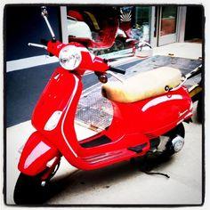 Vespa, so shiny and red!