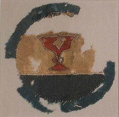 Fragment of Heraldic Emblem  Object Name: Fragment  Date: late 14th–mid-15th century  Geography: Egypt  Medium: Wool; appliqued and embroidered  Classification: Textiles-Embroidered  Accession Number: 1972.120.2