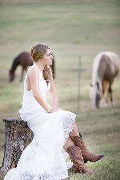 love everything about this picture - the dress, the horses, the location!