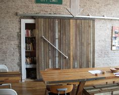 flat track door with reclaimed wood look. to separate artists studio from t. Rural Studio, Track Door, Fireplace Tv Wall, Family Dining Rooms, Sliding Doors, Barn Doors, Tap Room, Diy Wood Projects, Rustic Interiors