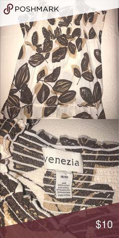 Leafy patterned tank Patterned tank, breezy fabric, ruffle detail at bottom Venezia Tops Tank Tops