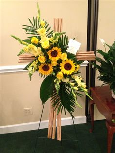 Breath taking funeral flowers. Love the rustic look of this arrangement.
