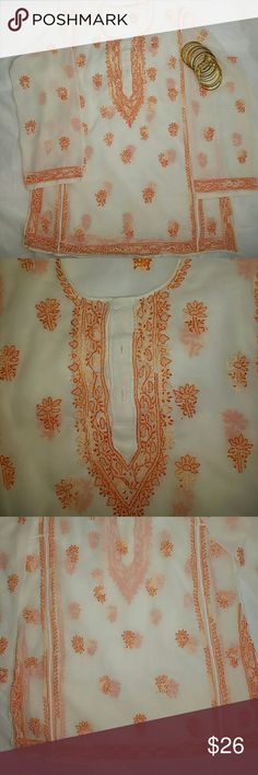 Embroidered Tunic or Beach cover up Beautiful cream n pastel orange color embroidered tunic can be worn with a cami or as a beach cover up.  Measurements - Bust - 22 (laying flat) 44 inches, Hips - 20 (laying flat)40 inches , Tunic length - 26.5 inches, Slide slits - 6 inches. Handwash and air-dry the tunic Tops Tunics