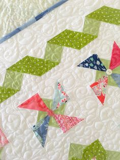 Summer Breeze, a Mini charm pack pattern by Carried Away Quilting. Sample features Aria by Kate Spain for Moda Fabrics. Vintage buttons.