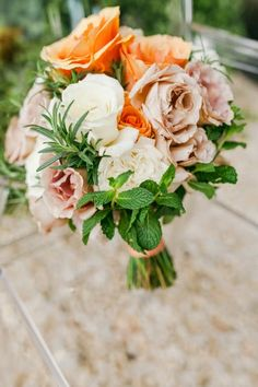 white, orange and mauve bouquet with springs of rosemary and mint by Tori Allen