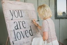 """""""You are loved"""" wooden sign people sign as guest book at rustic barn wedding.  Can hang on the wall in your new home!"""