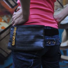 Our recycled inner tube belt bag is slim, as it is designed for urban trips. It is big enough for documents, a wallet, a cell phone and there is an optional place for cigarettes or for the second cell phone ;)  It has also a safety pocket on the back side. Both pockets are with zip.  It is waterproof and machine washable.  Available with 3 different colors of lining: yellow, red and black (black one is available with yellow and grey label).    Dimensions (cm): 20 x13 x 2