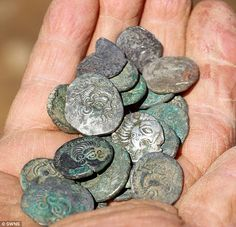 Pair of metal detector friends discover thousands of silver and gold Iron Age coins from 50BC worth £ 10 million buried in a field in Jersey after searching for 30 years.       The treasure is thought to have been buried by a Celtic tribe called the Coriosolitae, in the hope it could be dug up once the Romans had left.    Though Pinterest says the link is inappropriate, it's the Daily Mail and this isn't an article about cancer, royalty or the goverment.