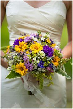 Bridal wedding bouquet with helianthus, hyssop, amaranthus, yellow white blue, centaurus, valerian,
