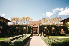 A look into the iron gates and archway of Villa Siena! | villasiena.cc