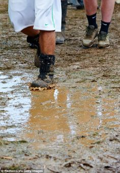 Festival goers negotiate mud caused by heavy rain showers during the second day of Leeds F. Enjoy The Sunshine, Rain Shower, Music Festivals, Leeds, Mud, Showers, Two By Two, Rain, Shower