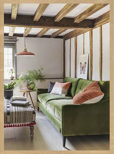 green velvet sofa, big pillows, green + ivory + coral