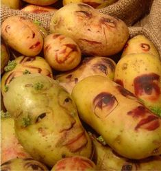 Ginou Choueiri's Potato Portraits. The small one in the middle looks like he might be baked.