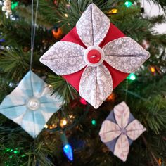 These pretty fabric ornaments are so easy to make! Start with a stitched circle and fold to create the final flower shape. Hang the finished ornament as-is, or add a special button to the center of the ornament for a special touch. #DIY #ornament #holiday #christmas #christmastree #free #tutorial