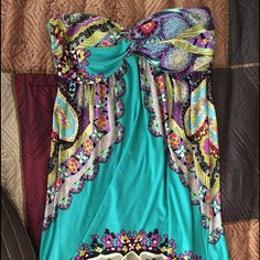 Beach cover up or a small dress Venus Multi color Multiple color beach cover up or a super cute sun dress. Size small. Slightly padded bust, elastic back. Stretchy. Prices low since the back hem has started to come loose. See pic. It's not noticeable on. Venus Dresses Mini