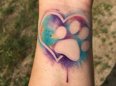 Watercolor heart and paw print tattoo by Daniel Baker