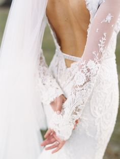 Lace backless wedding gown: Gown: Berta Bridal - http://www.stylemepretty.com/portfolio/berta-bridal-2 Photography: Lisa Ziesing for Abby Jiu Photography - abbyjiu.com Read More on SMP: http://www.stylemepretty.com/2017/06/12/european-garden-inspired-wedding-on-the-eastern-shore/