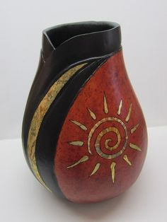 This gorgeous gourd vase is inches tall and inches in diameter The mahogany colored base is set off with carved ripples and rim in black The sunburst and curved moon Decorative Gourds, Hand Painted Gourds, Native American Pottery, Native American Art, Gourd Art, Indian Art, Rock Art, Painted Rocks, New Art