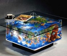No bachelor pad would be complete without an over the top item like an aquarium coffee table. Both stylish and functional, this coffee table aquarium comes complete with decorative aquarium plants, lighting, filtration pumps, and everything else you'll need.