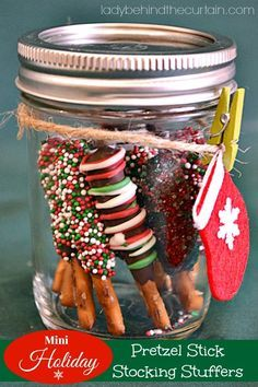 Mini Holiday Pretzel Stick Stocking Stuffers - - For a fun gift, add pretzels to a clear plastic candy cane or small mason jar. Teacher Christmas Gifts, Christmas Stocking Stuffers, Christmas Goodies, Christmas Treats, Christmas Fun, Holiday Fun, Holiday Gifts, Baked Goods For Christmas Gifts, Stocking Stuffer Ideas