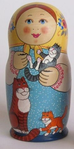 Funny matryoshka (Russian nesting doll) with a serious cat and two merry kittens.