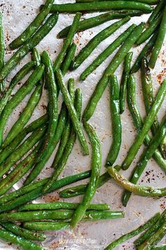green beans   olive oil   salt  pepper   garlic powder  parmesan. 425 degrees for 10 min. shake. then another 5 min.add parm cheese. Yum!