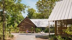 Six pine buildings form this storm-resilient marine research centre in Mississippi designed by US architecture firm Lake Flato Architects. Ocean Springs Mississippi, Lake Flato, Covered Walkway, Tree Canopy, Pedestrian Bridge, Education Center, Architect Design, Pavilion, Facades