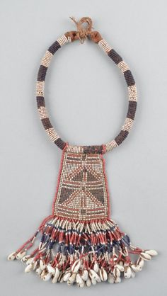 Neck ornament (woman's) made of beads (glass), shells (cowrie).
