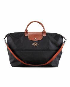 Le Pliage Monogrammed Expandable Travel Bag, Black by Longchamp at Neiman Marcus.