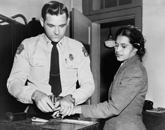 Rosa Parks being fingerprinted during 1956 arrest for participation in the Montgomery bus boycott.