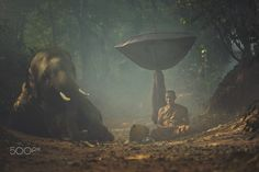 Monk Bhuddalist and his elephant in elephant homestay Surin Thailand