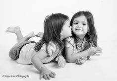 2 1/2 - year old twin sisters by Sonya Lira Photography Manvel, Texas Natural photo session just playing in the studio. Notice the feet touching.