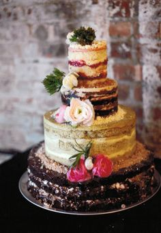 multi-flavored naked wedding cake. very neat idea, and looks so creative! love naked cakes!