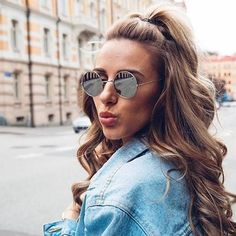 @skopljak is sending out sweetheart vibes and flaunting her feminine side  in this romantic half up hairdo . She adds gorgeous curls and round sunnies to complete her stellar look of the day✨ .  #hairoftheday #NuMeStyle #loosecurls