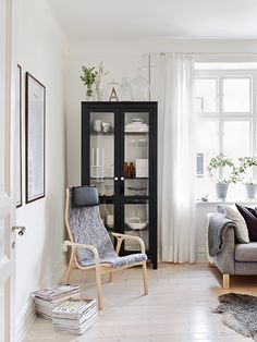 Ikea Hemnes Glass Door Cabinet  and the couch is as well Livet Hemma black white scandinavian modern living room