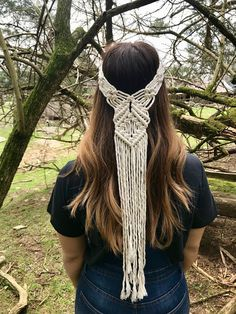 This macrame headpiece was handmade with soft, natural white cotton rope. Delicately knotted to fit snugly around the head. The perfect accessory to wear for some fringy fun at festivals or for a unique boho bridal look! Measures approx. 19 circumference and 22 from the top of the back