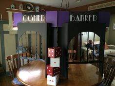 Banker/cashier booth made from trifold presentation foam core board. Dice made from cigar boxes Homecoming Decorations, Casino Party Decorations, Casino Theme Parties, Party Centerpieces, Casino Royale Movie, Las Vegas With Kids, Casino Night Food, Party Food Themes, Poker Party