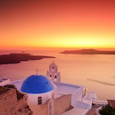 Blue Dome Church St. Spirou in Firostefani on the Island of Santorini Greece, at Sunset Photographic Print