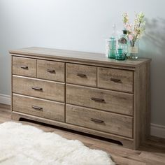 This traditional-style dresser features Six (6) convenient drawers with antique pewter finish metal handles. The top drawers are separated by a decorative groove that creates the illusion of double dr