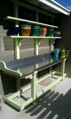 Potting bench with steel top. Simple but very easy to keep clean.