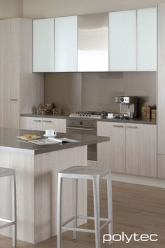 Overhead cupboard doors  in Starphire White glass insert Overhead cupboard door frames  in 5mm/55mm Brushed Stainless