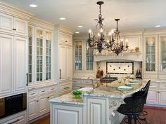 Looking for White Traditional Kitchen ideas? Browse White Traditional Kitchen images for decor, layout, furniture, and storage inspiration from HGTV. Kitchen Cabinet Colors, White Kitchen Cabinets, Glass Cabinets, Kitchen Backsplash, Kraftmaid Cabinets, Green Cabinets, Kitchen Cupboard, Dark Cabinets, Kitchen Shelves