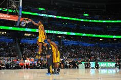 Paul George, who was selected to be a participant of the 2012 NBA Dunk Contest, proved his jumping ability when he dunked over teammates Roy Hibbert (7'2'') and Dahntay Jones (6'6'').   #SeePGFly