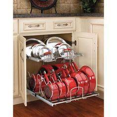 I want this so bad  So sick of pots falling out!!  This cabinet organizer has independently moving baskets for easy access to top and bottom shelves.