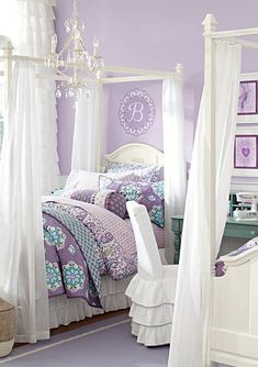 Gorgeous little girl's room - loving the lavender walls and those canopy beds!
