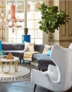 Jonathan Adler is not afraid of mixing and matching. This living room incorporates sculptural furniture like the Milano Wing Chair and Danner Curved Sectional (both in blue tonal velvets) that bring life to the room.