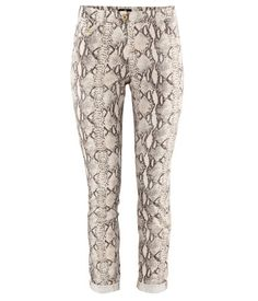 I don't know what about the pattern has me really hooked, but these pair of snakeskin patterned pants are so chic. You could pair them with a loose white chiffon blouse during the day, or a black top at night.