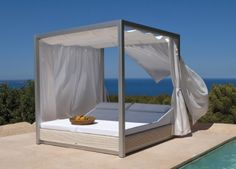 This Sunset Double Sunbed allows you to get away from the sun, but not the pool. #housetrends
