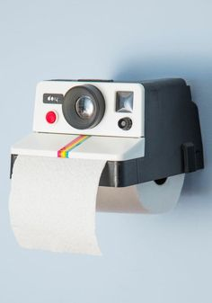 Polaroid toilet tissue holder - hilarious! #product_design